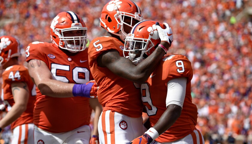 Clemson's Travis Etienne (9) celebrates his touchdown with Tee Higgins (5) and Gage Cervenka during