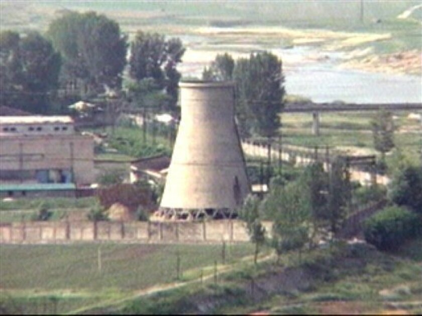 FILE - In this June 27, 2008 file photo from television, the 60-foot-tall cooling tower is seen before its demolition at the main Nyongbyon reactor complex in Nyongbyon, also known as Yongbyon, North Korea. North Korea vowed Tuesday, April 2, 2013, to restart a nuclear reactor that can make one bomb's worth of plutonium a year, escalating tensions already raised by near daily warlike threats against the United States and South Korea. The North's plutonium reactor was shut down in 2007 as part