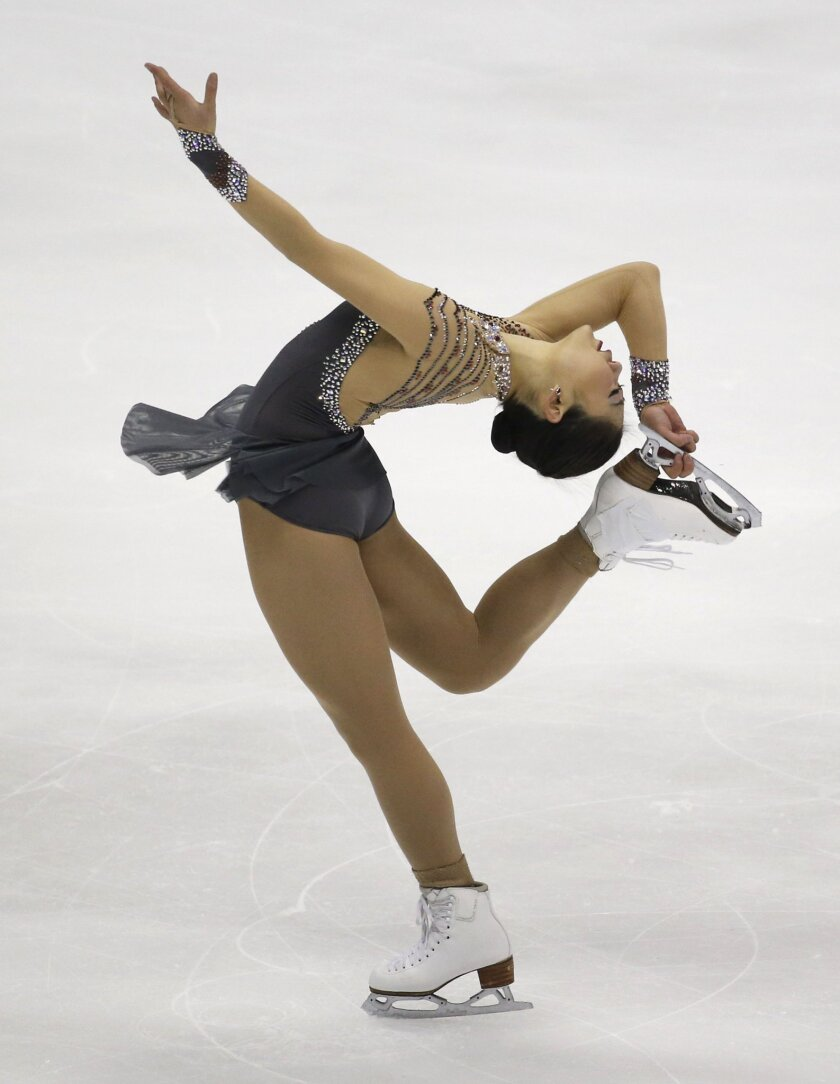 Mirai Nagasu of the United States performs during the Ladies Short Program of the Taiwan ISU Four Continents Figure Skating Championships in Taipei, Taiwan, Thursday, Feb. 18, 2016. Nagasu finished in third place. (AP Photo/Wally Santana)