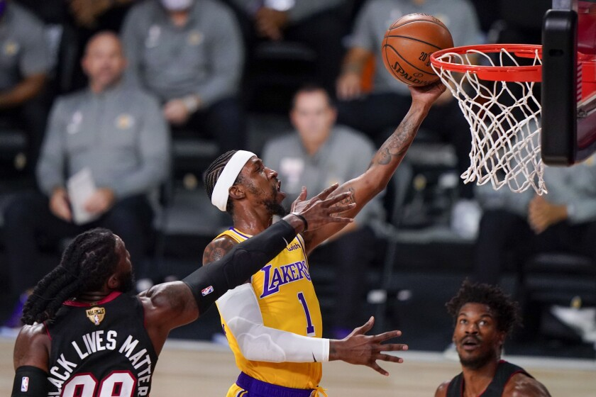 Lakers guard Kentavious Caldwell-Pope gets to the rim past Miami Heat forward Jae Crowder during Game 4 of the NBA Finals.
