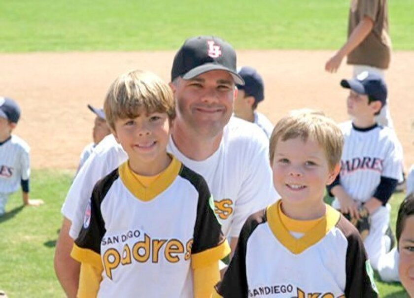 Coach Chris Circuit with his sons Jack and Mitch of the Voices for Children team in La Jolla Youth Baseball's Shetland division. (Courtesy Photo)