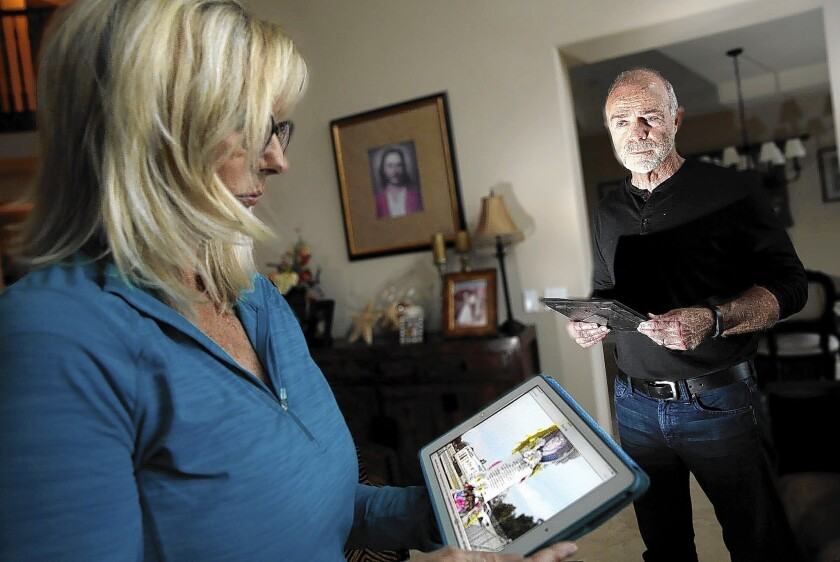 Teri and James Kennedy look at photos of a roadside memorial for their son Joseph, who died from a prescription drug overdose. Now the couple are trying to improve treatment for young people struggling with addiction.