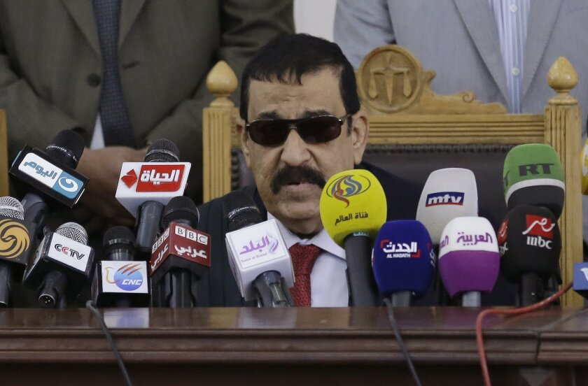 Egyptian Judge Nagy Shehata reads the verdicts in a case rooted in violence that swept the country after the military-led ouster of Islamist President Mohamed Morsi in 2013.