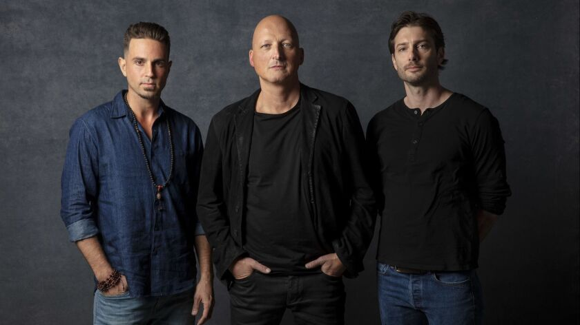 """Wade Robson, left, director Dan Reed, and James Safechuck from the documentary """"Leaving Neverland,"""" which premiered at Sundance on Friday."""