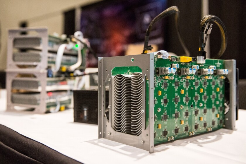 Bitcoin mining hardware is displayed at a bitcoin conference in New York City.