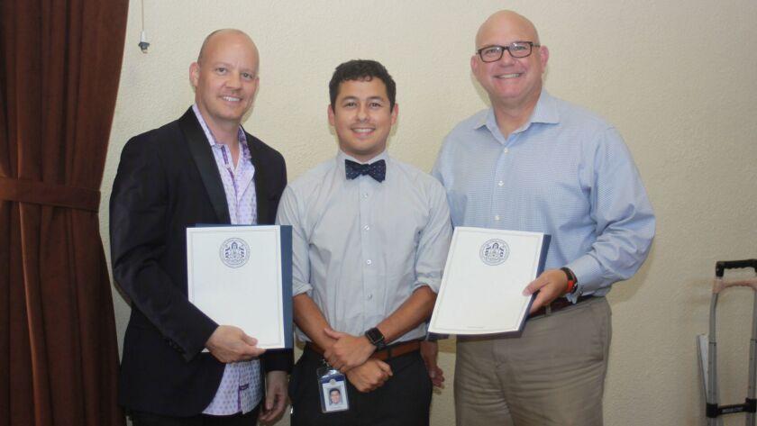 City Council member Barbara Bry's rep Mauricio Medina (center) presents La Jolla Town Council outgoi