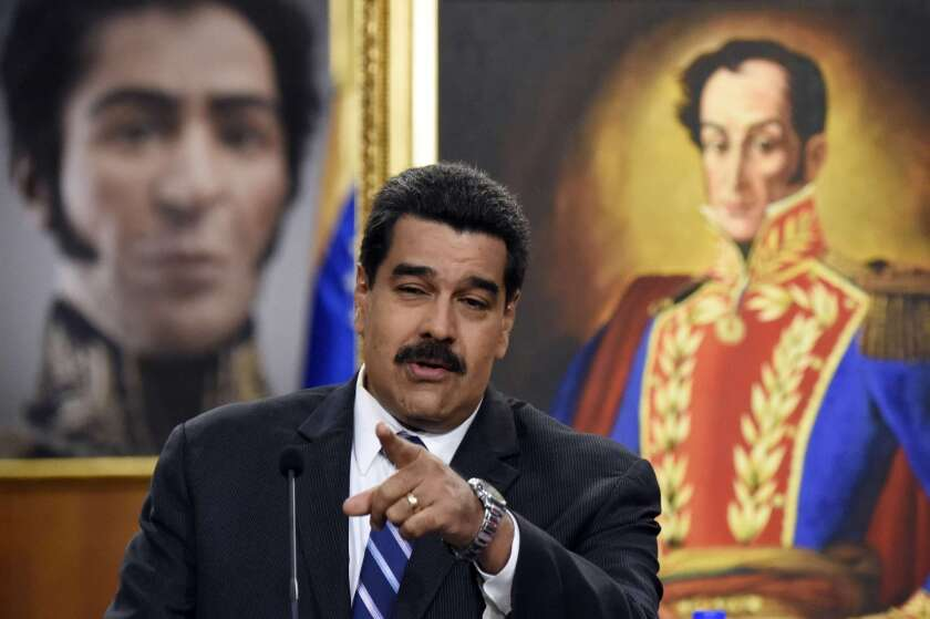 Venezuelan President Nicolas Maduro speaks during a press conference at the Miraflores presidential palace in Caracas on Tuesday.