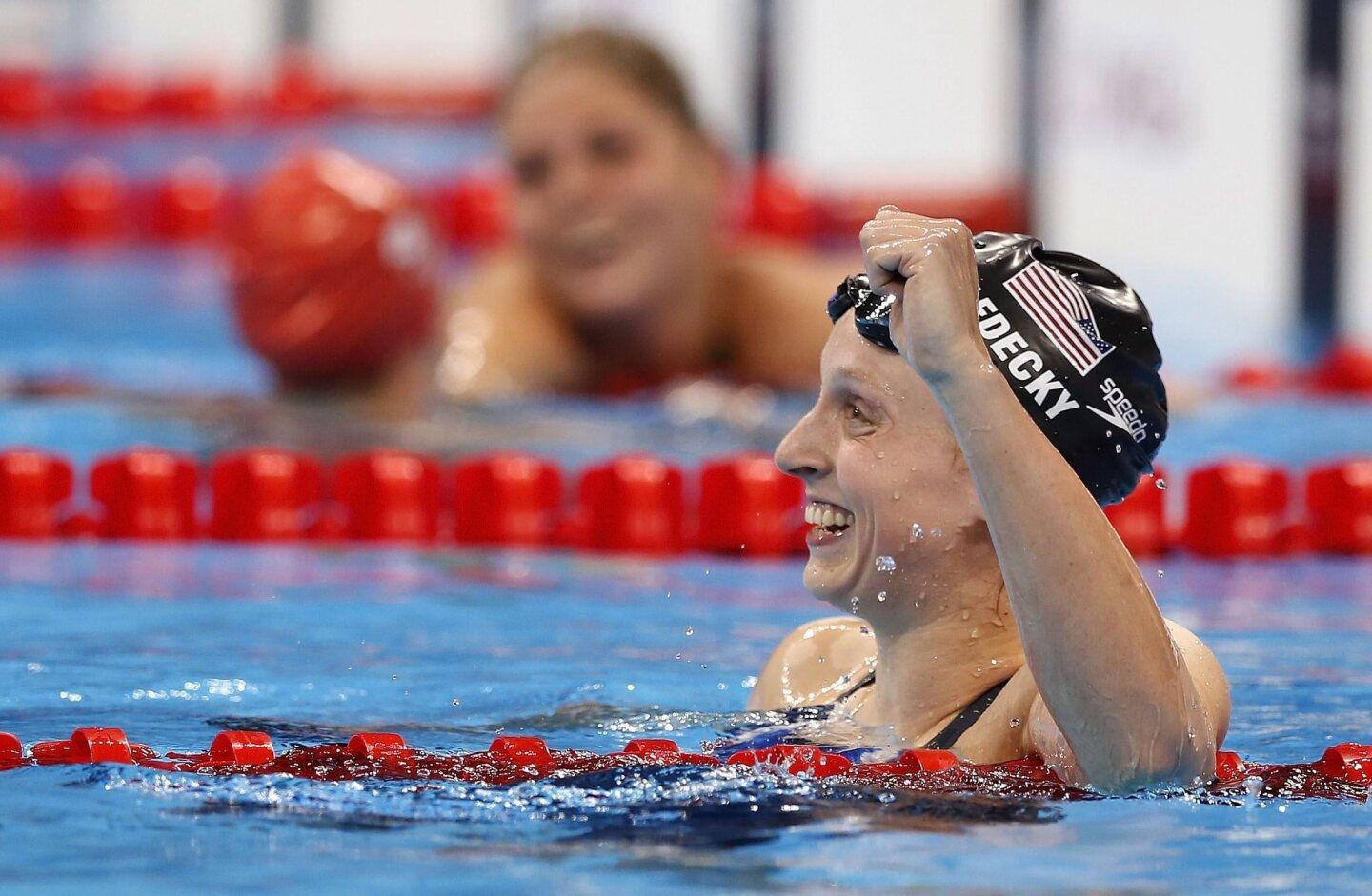Katie Ledecky of USA celebrates after winning in the women's 800m Freestyle Final race of the Rio 2016 Olympic Games Swimming events at Olympic Aquatics Stadium at the Olympic Park in Rio de Janeiro, Brazil.
