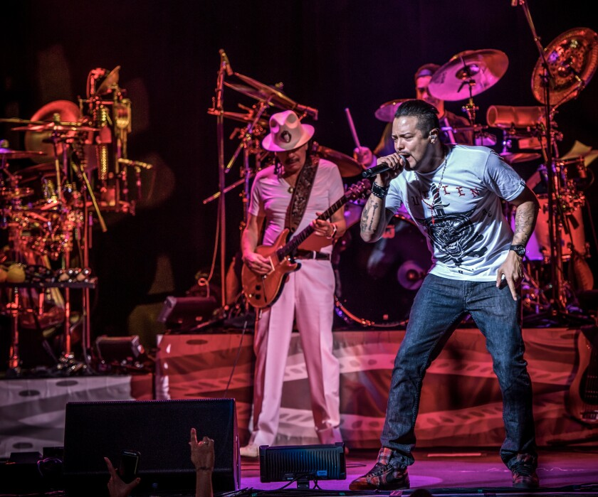 """I am really living a dream every day of of my life,"" says singer Andy Vargas (right) who joined Santana, the band by former Tijuana guitarist Carlos Santana, nearly 20 years ago. ""Carlos is such an inspiration."""