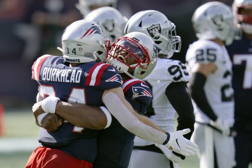 New England Patriots running back Rex Burkhead celebrates with quarterback Cam Newton.