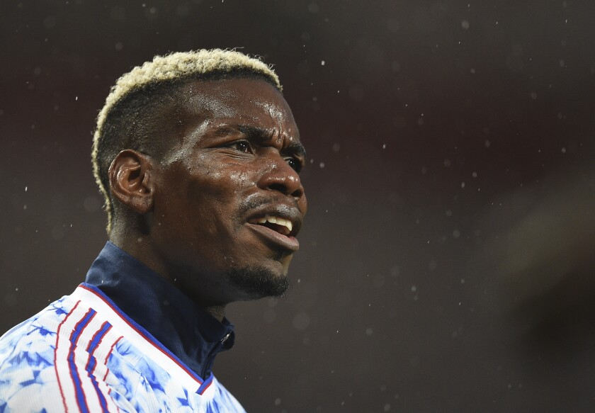 Manchester United's Paul Pogba during the warm up before the English Premier League soccer match between Manchester United and Chelsea, at the Old Trafford stadium in Manchester, England, Saturday, Oct. 24, 2020. (Oli Scarff/Pool via AP)