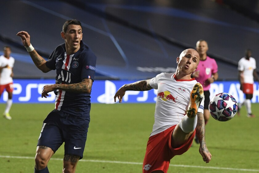 PSG's Angel Di Maria, left, challenges for the ball with Leipzig's Angelino during the Champions League semifinal soccer match between RB Leipzig and Paris Saint-Germain at the Luz stadium in Lisbon, Portugal, Tuesday, Aug. 18, 2020. (David Ramos/Pool Photo via AP)