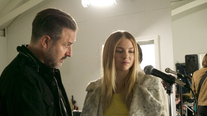 """David Arquette and Allie Gonino appear in a scene from the movie """"High Voltage."""""""