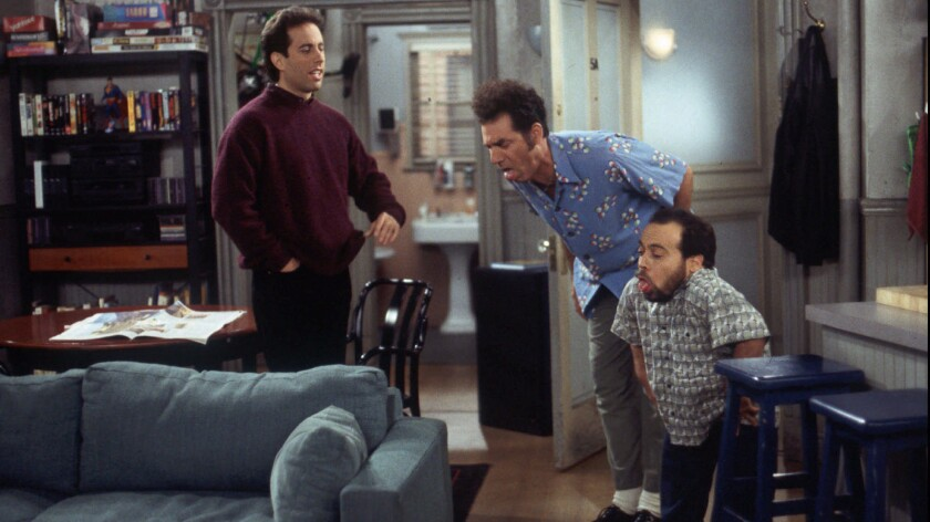 "Danny Woodburn, right, guest stars on an episode of ""Seinfeld"" with regulars Jerry Seinfeld, left, and Michael Richards."
