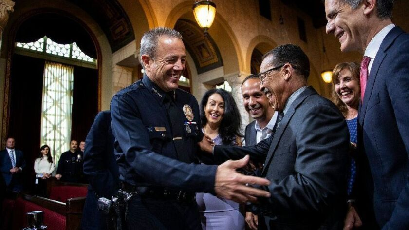 Michel Moore, seen on June 26 after being sworn in as LAPD chief, briefly retired from the force and received a $1.27-million DROP payout before Mayor Eric Garcetti tapped him to head the Police Department.