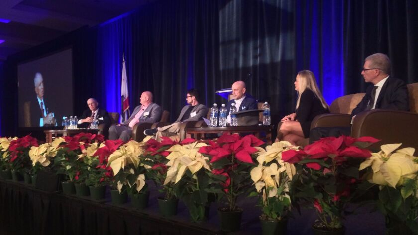 Analysts gave predictions for 2017 at IREM's 29th Annual Real Estate Economic Forecast Breakfast. Left to right: Terry Magee, Epsilon Systems Solutions; Jason Wood, Cisterra Development; Neal Bloom, Hired.com; Dennis Cruzan; Liza Strom, Irvine Co.; and consultant Gary London.