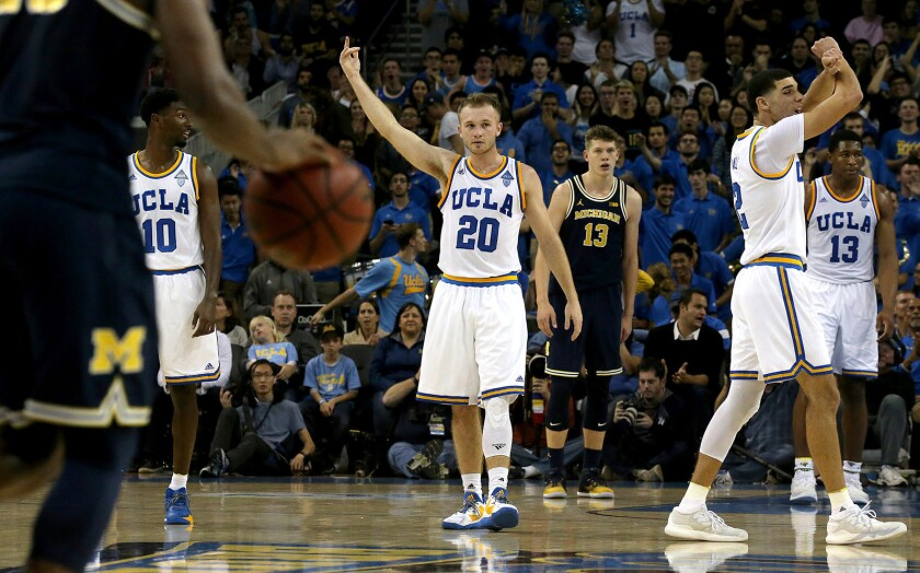 UCLA guard Bryce Alford (20) and his Bruins teammates celebrate after an Alford basket late in the second half of a game against Michigan on Dec. 10.