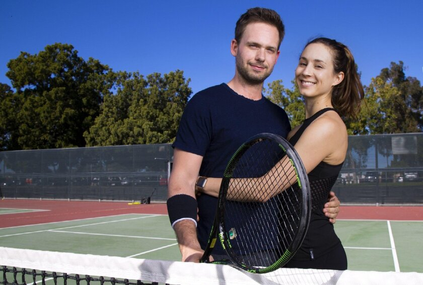 "Patrick J. Adams and his fiancee, Troian Bellisario, pictured at the Balboa Tennis Club, play a married couple in ""The Last Match."""