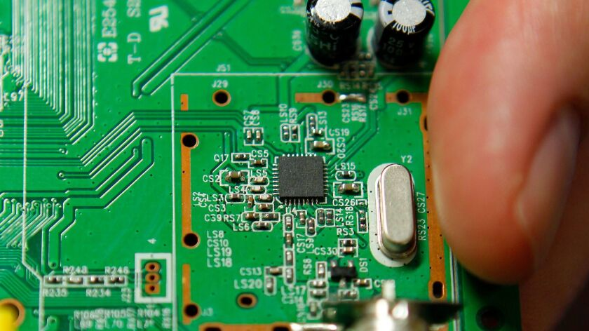 January 10th, 2012, Las Vegas, Nevada, USA. | A MaxLinear chip on a circuit board at the Consumer El