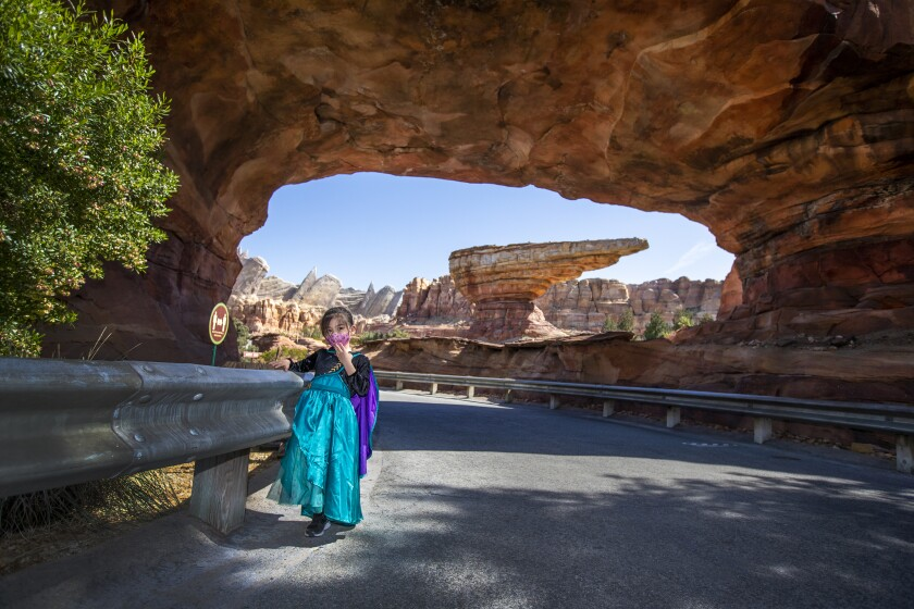Ally Carrasco poses for a photo at the scenic entrance to Cars Land