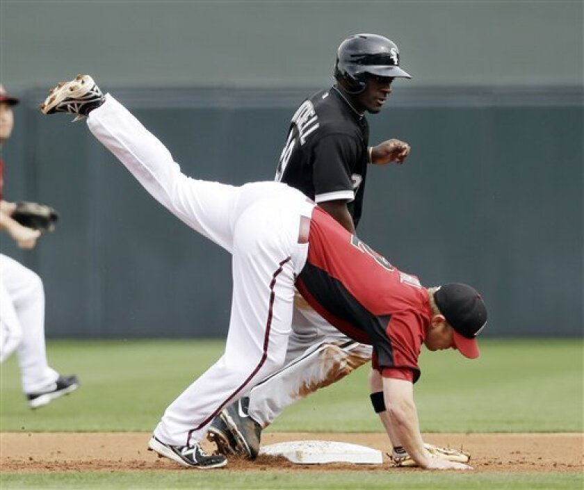 Chicago White Sox's Jared Mitchell, top, steals second base as he collides with Arizona Diamondbacks second baseman Aaron Hill during the second inning of an exhibition spring training baseball game on Saturday, March 9, 2013 in Scottsdale, Ariz. (AP Photo/Marcio Jose Sanchez)
