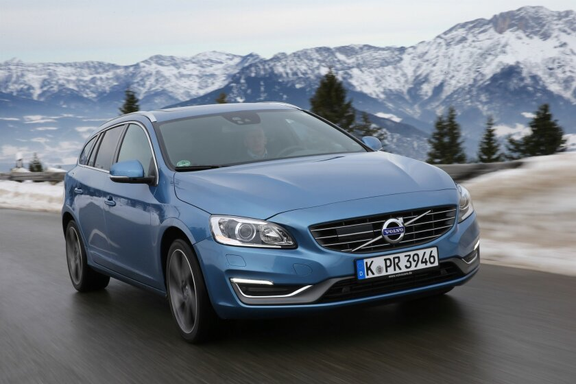 This undated photo provided by Volvo shows the 2016 Volvo V60. The Volvo V60 Cross Country has Scandinavian style, but the standard model lacks the rearview camera. (Volvo via AP)