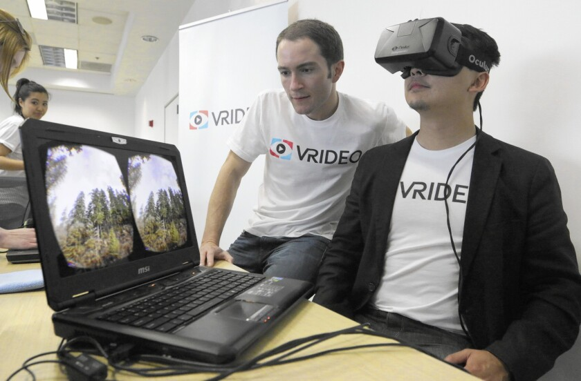 """Vrideo co-founders Alex Rosenfeld, left, and Kuangwei Hwang have raised $1.8 million from investors to become the YouTube for """"immersive video."""""""