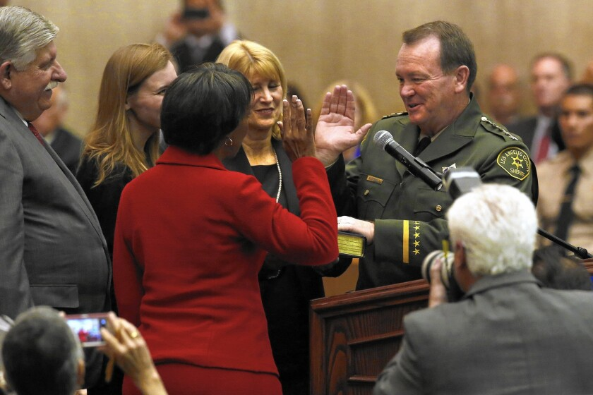 Sheriff Jim McDonnell is sworn in by Los Angeles County Dist. Atty. Jackie Lacey.