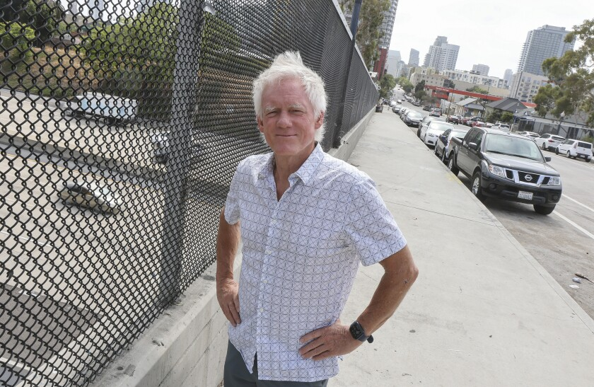 Roger Lewis, of the nonprofit San Diego Commons, stands on the Island Avenue overpass Wednesday in San Diego.
