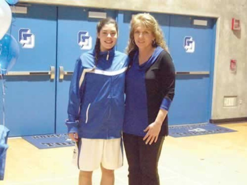 All Star Kelsey Plum poses with La Jolla Country Day School Girls Basketball Coach Terri Bamford. Michael Ragovin