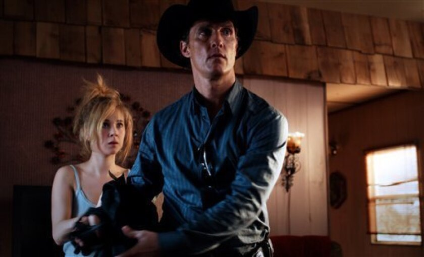 """This film image released by Independent Pictures shows Matthew McConaughey and Juno Temple, left, in a scene from """"Killer Joe."""" (AP Photo/Independent Pictures)"""