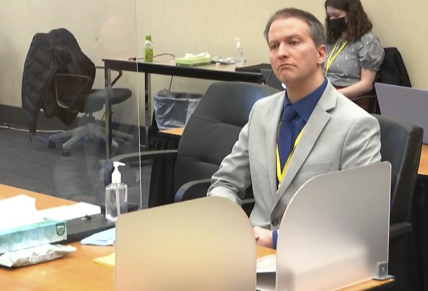 Former Minneapolis police officer Derek Chauvin listens in court
