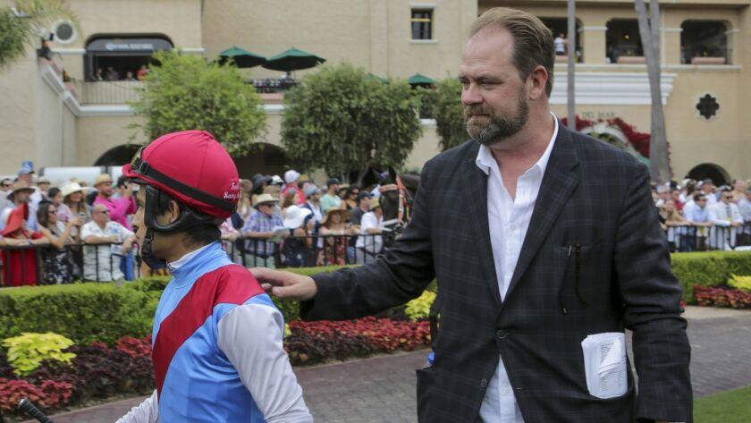 Trainer Doug O'Neill accompanys jockey Mario Gutierrez to horse Shane Zain in the paddock for the