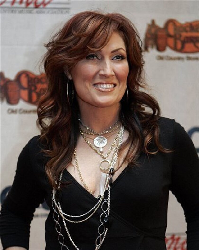 In this Nov. 5, 2006 file photo, Jo Dee Messina arrives for the Songs of the Year Concert presented by Cracker Barrel at Schermerhorn Symphony Center in Nashville, Tenn.  (AP Photo/Chitose Suzuki, file)