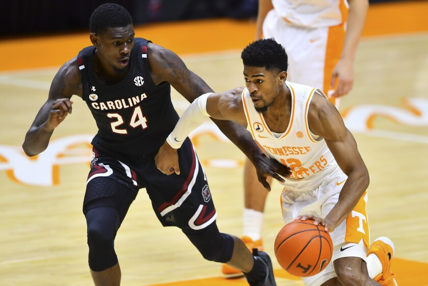 South Carolina's Keyshawn Bryant defends against Tennessee's Victor Bailey Jr.