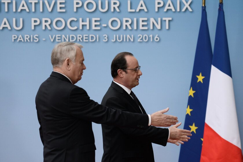 French President Francois Hollande and his Foreign Affairs minister Jean Marc Ayrault, left, arrive to attend an international meeting in a bid to revive the Israeli-Palestinian peace process in Paris, France, Friday, June 2, 2016. U.S., European and Arab diplomats meet in Paris for a French-led ef