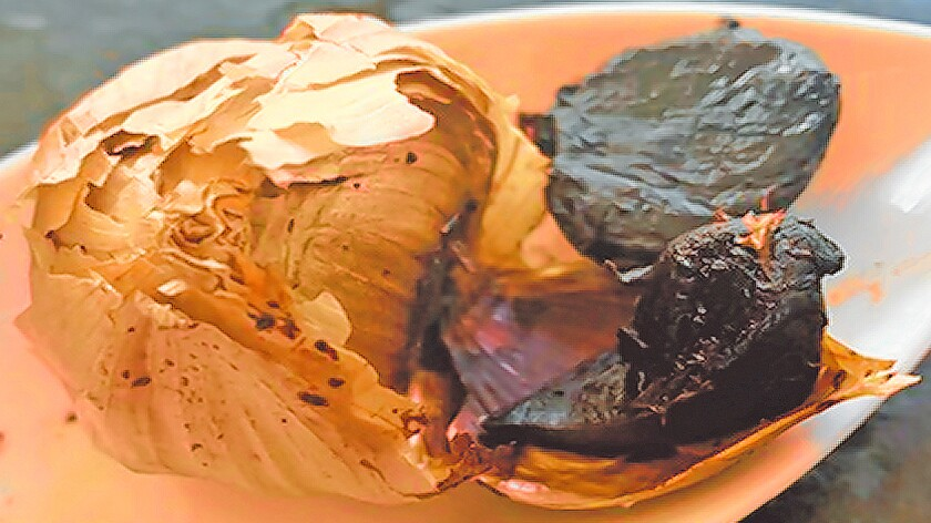 Black garlic is ordinary garlic that has been fermented under high heat until cloves turn black. The heat brings out natural sugars for what some consider a sweeter taste.