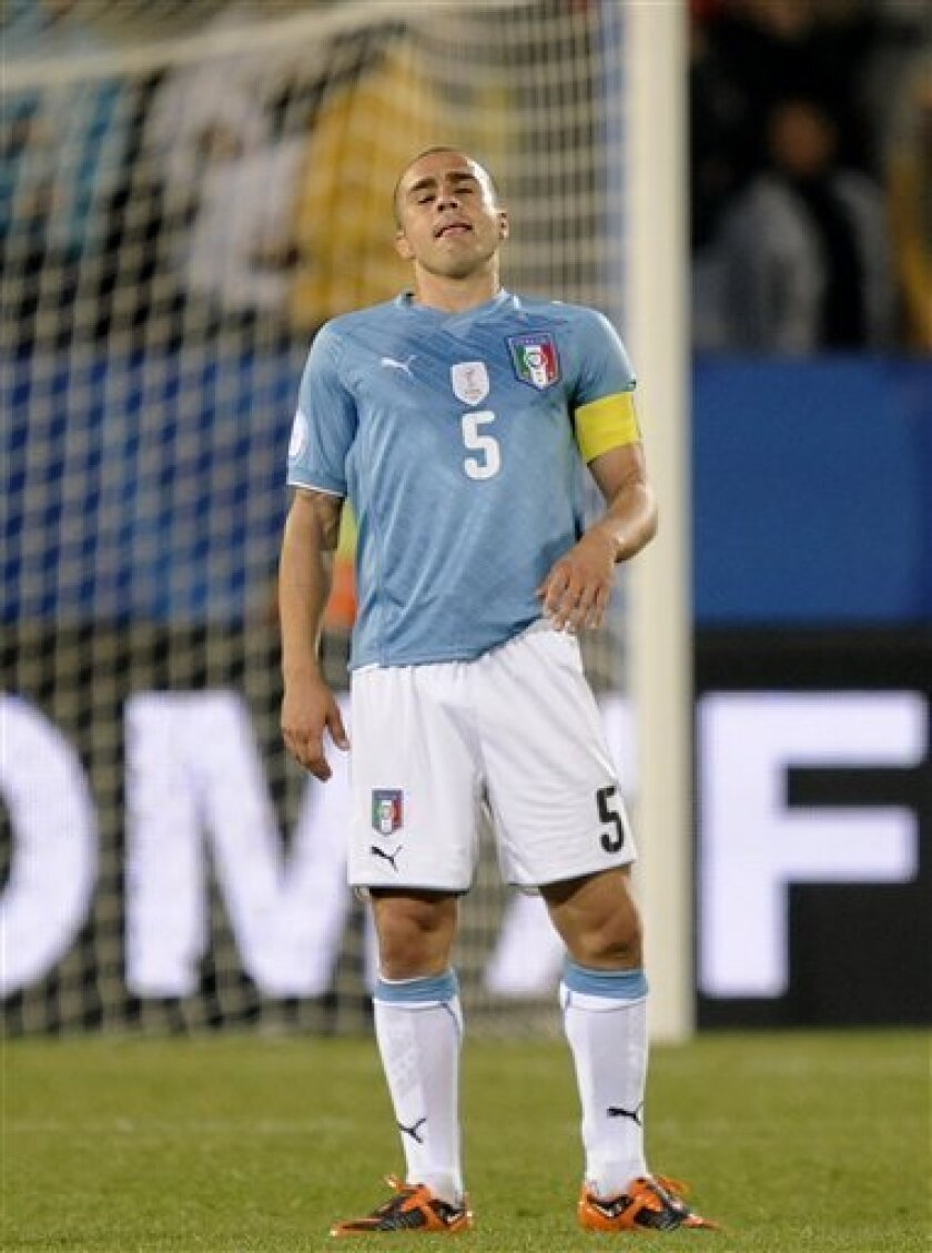 FILE - In this Sunday, June 21, 2009 file photo, Italy's Fabio Cannavaro reacts after teammate Andrea Dossena, not pictured, scored an own goal during their Confederations Cup Group B soccer match against Brazil, at Loftus Versfeld Stadium in Pretoria, South Africa. Italy captain Fabio Cannavaro has failed a doping test. His club team Juventus says, Thursday, Oct. 8, 2009, the positive exam was the result of a cortisone used to treat a bee sting. The Italian Olympic Committee's anti-doping prosecutor Ettore Torri has opened an investigation. Cannavaro was already suspended for Italy's World Cup qualifier with Ireland on Saturday, but he was expected to join the team for Wednesday's game against Cyprus. (AP Photo/Martin Meissner, File)