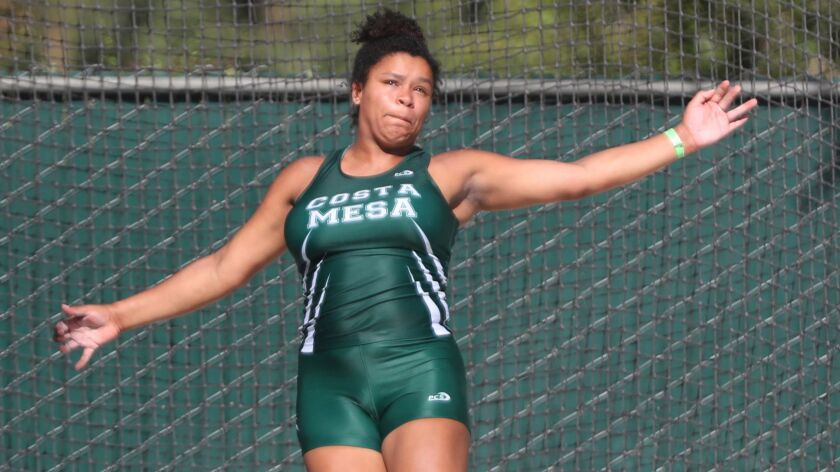Costa Mesa High School athlete Tayla Crenshaw looks at her throw in the girls discus throw at the 10