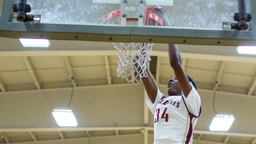 Mission Hills High School's Warren Washington dunks during the Grizzlies' win against Pasadena La Salle on Saturday.