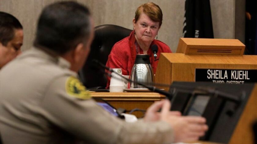 Los Angeles County Supervisor Sheila Kuehl listens to Sheriff Alex Villanueva during a hearing in January over his controversial reinstatement of a deputy, Caren Carl Mandoyan, who was fired over allegations of domestic violence.