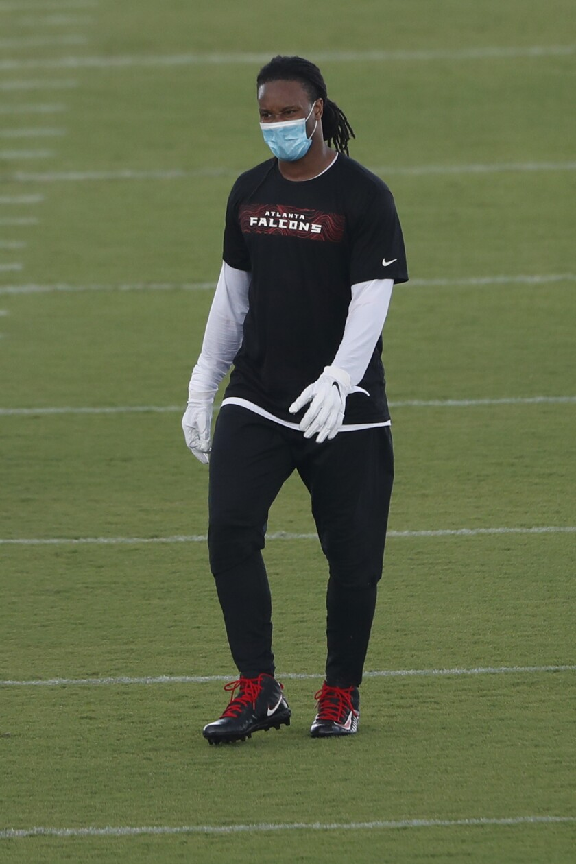 Atlanta Falcons running back Todd Gurley wears a protective face covering between drills during a strength and conditioning NFL football workout Monday, Aug. 3, 2020, in Flowery Branch, Ga. (AP Photo/John Bazemore, Pool)