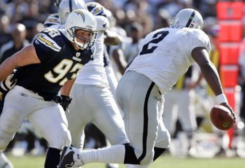 Chargers' Luis Castillo sacks Raiders QB JaMarcus Russell in the fourth quarter Sunday. K.C. Alfred/Union-Tribune