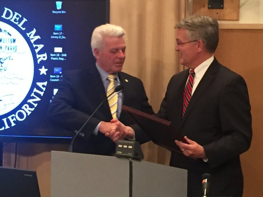 San Diego County Supervisor Dave Roberts presents a proclamation in honor of outgoing Mayor Al Corti's service.