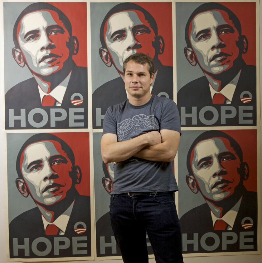 """Los Angeles street artist Shepard Fairey in front of the Barack Obama """"hope"""" artwork for which he is most famous."""