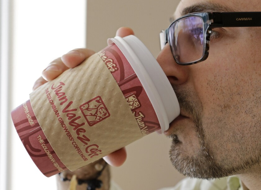 A man enjoys a coffee at a cafe in Miami. According new a new study, journalists and those that work in media drink the most coffee.