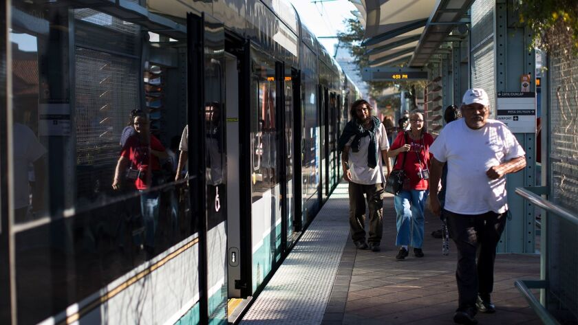 Shade structures keep pedestrians cool at a Metro light rail stop at McDowell and Central stop in do