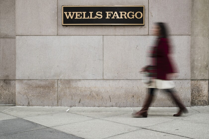 FILE - In this Nov. 29, 2018, file photo shows a Wells Fargo bank location in Philadelphia. Wells Fargo & Co. reports financial results on Tuesday, Jan. 14, 2020. (AP Photo/Matt Rourke, File)