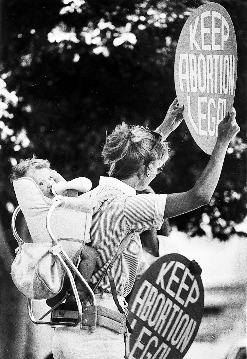 The Alan Guttmacher Institute reports this week that the national abortion rate dropped between 2008 and 2011. Above, a woman demonstrates for abortion rights in January 1998 in L.A.