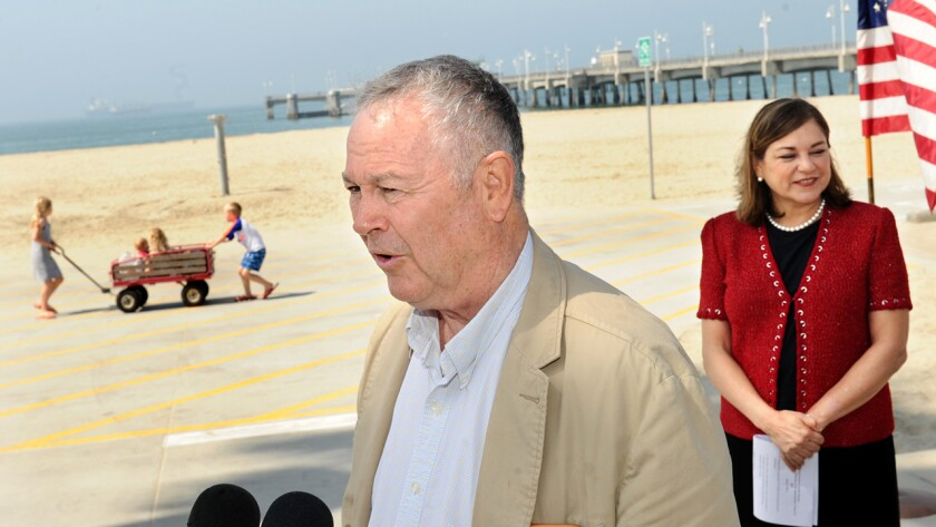 U.S. Rep. Dana Rohrabacher (R-Costa Mesa) appears with U.S. Rep. Loretta Sanchez (D-Santa Ana) at Belmont Pier in Long Beach to promise federal action to help prevent and mitigate the damage of coastline oil spills.